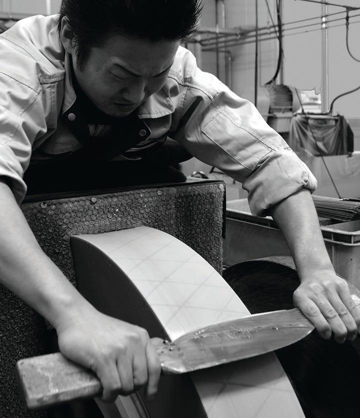 Man grinding knife