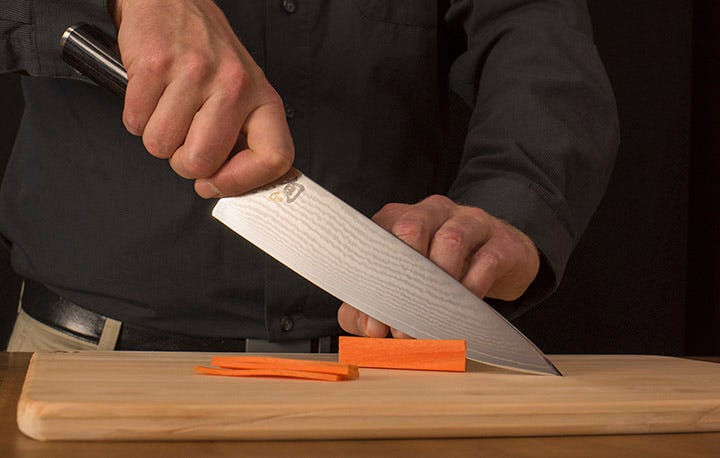 Shun Chef's knife slicing carrots